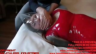Keter In Latex Outfit Hard Bag Breathplay