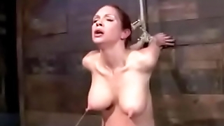 Redhead suffering tied up to the wall!!! -Punishland.com
